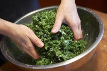 Your hands are the best mixing tool for these salads to ensure that all the kale gets coated with dressing.